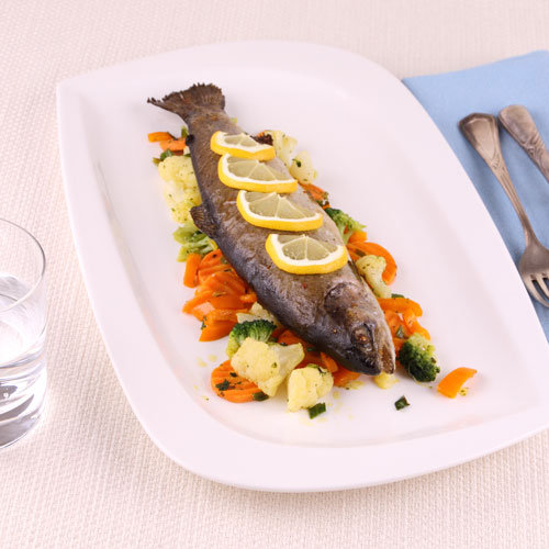 RestaurantDemo/menisto_44066935-Grilled-whole-trout-with-vegetables-and-cutlery.jpg